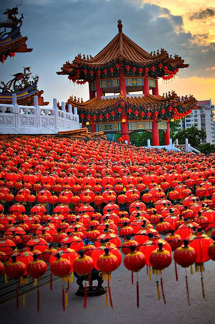 Thean Hou Temple in Kuala Lumpur features a multi-arched gateway with red pillars. The color red symbolizes prosperity and good fortune.