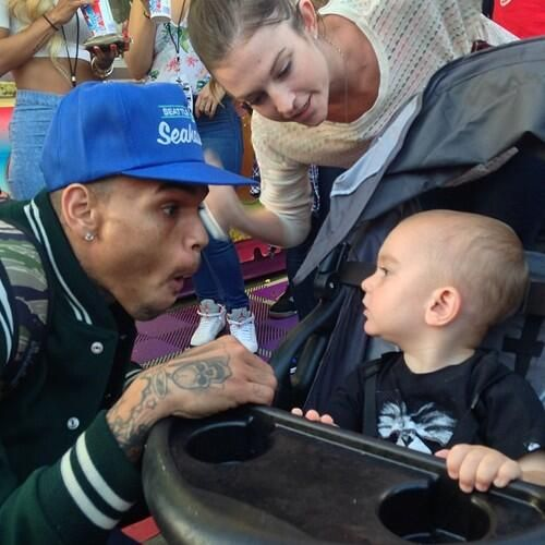 AWW! CUTE PICTURE Of Chris Brown Making Faces To A Baby Yesterday via @ChrisBrownRCA