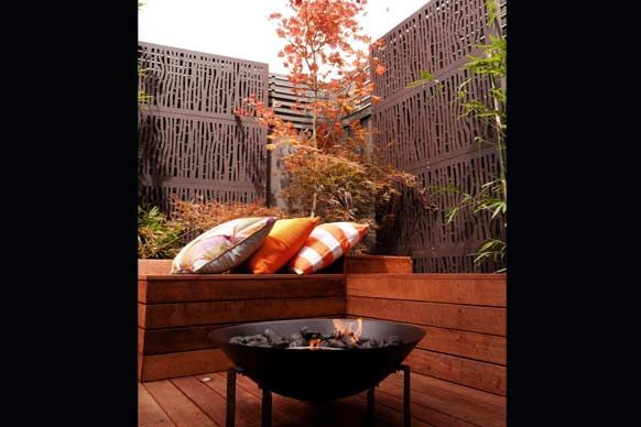 Dani and Dan from The Block's fire pit and Japanese maple