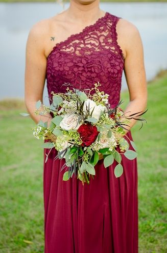 Wine colored bridesmaid dresse with lush foliage bouquet.