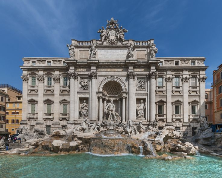 Toss a coin into the Trevi Fountain, which depicts classical figures in sumptuous detail. This example of late Baroque, or almost even Rococo, architecture, is lighter in many ways. It's not as formal as earlier Roman Baroque architecture, as it conveys its grandeur less strictly with more free-flowing opulence.