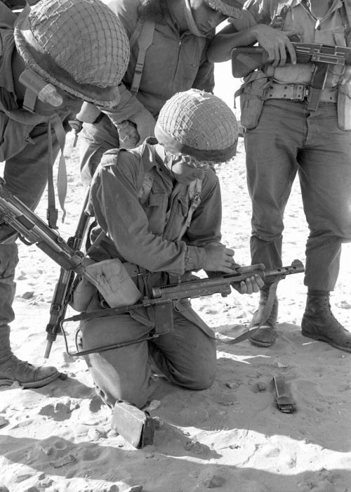 An Israeli Defense Force soldier unloads a captured Carl Gustaf m/45 submachine gun in the Sinai during the Six Day War (1967). Note that the IDF soldiers are all armed with wooden-stocked Uzi submachine guns.
