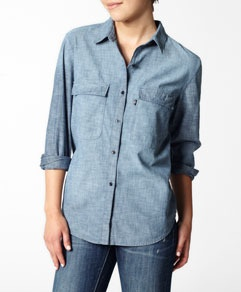 this chambray shirt has more of a boyfriend fit.  Love the oversize front pockets.  A small or medium would work for you