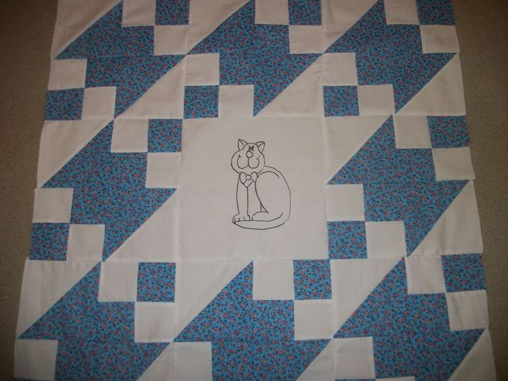 I HAVE FOR YOUR CONSIDERATION A NEWLY HANDMADE MACHINE SEWN QUILT TOP FEATURING THE CUTIEST WHIMSICAL KITTY. JUST HAND DRAWN WITH BLACK FABRIC MARKER {PERMANENT} SHE IS SURROUNDED IN A SNOW WHITE BACKGROUND ALONG WITH BLUE FABRIC WITH PINK BLOSSOMS.   eBay!