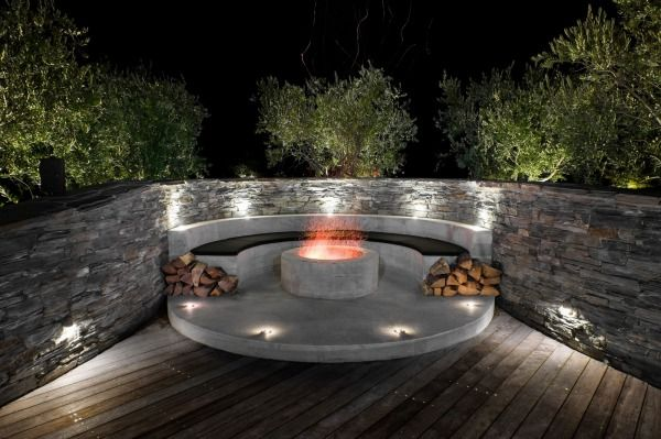 A fire pit beside the bocce court creates another intimate seating area.