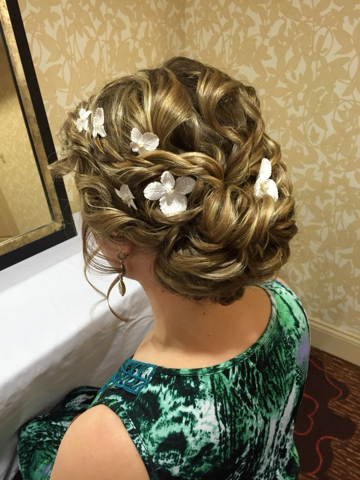 Loose Curly Updo With Flowers