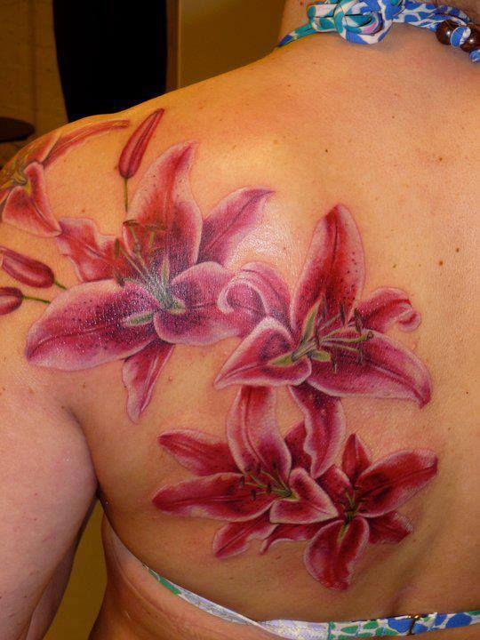 Stargazer Lilies Tattoo on girl's back