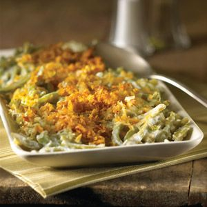 Green beans, in a rich, sour cream sauce and topped with both Swiss cheese and crunchy Kellogg's Corn Flakes® cereal, make an elegant casserole.