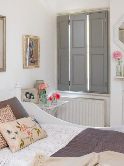 I like the plain shutters with the trim making them stand out ... A different touch