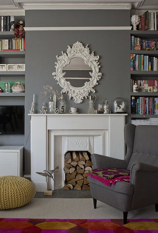 Beautiful fireplace, gorgeous shelves and grey walls in Milly Goodwin's amazing London flat. See more on Wear & Where