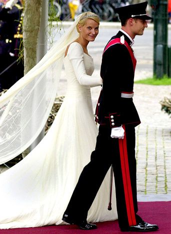Most Amazing Royal Wedding Dresses Ever...Crown Princess Mette-Marit of Norway...In 2001, the single mother married the Crown Prince of Norway in a simple silk crepe and tulle long-sleeve Ove Harder Finseth gown with a nearly 20 foot train. Her antique tiara was a gift from the King and Queen.