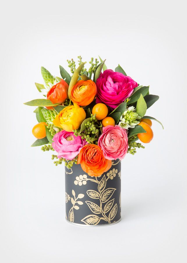 When life gives you kumquats… mix 'em up with bright ranunculus and throw 'em in a custom-wrapped Rifle Paper Co. tin.