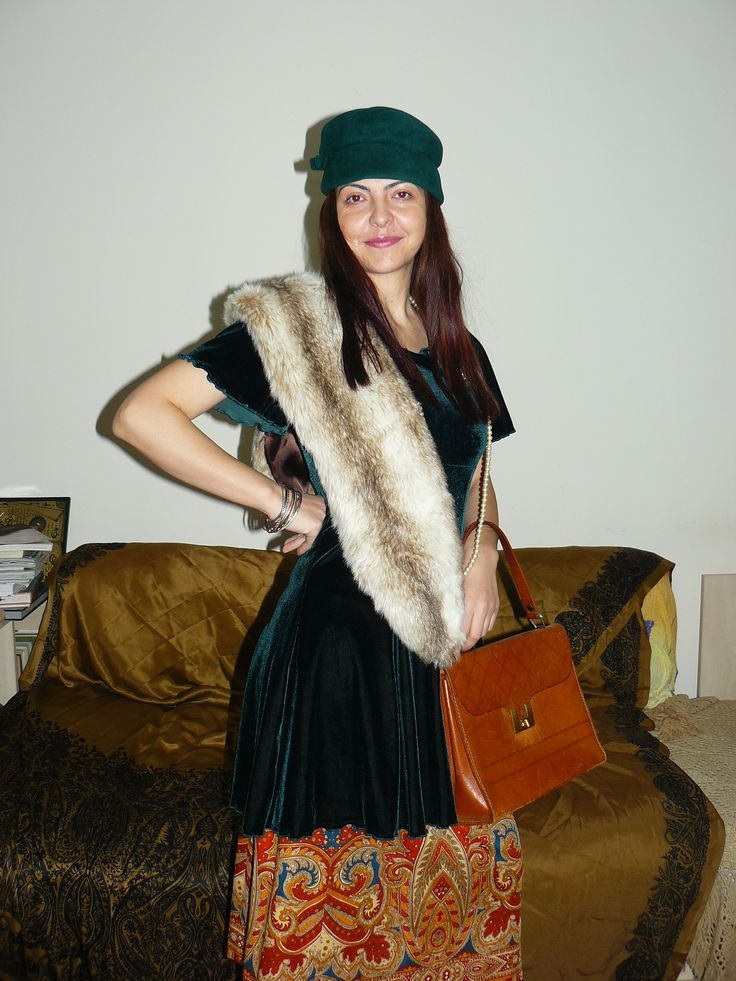 Vintage 70s psychedelic skirt (under the dress), vintage bag, vintage green hat - (both from the 50s), worn with a velvet dress and a fake fur stole.