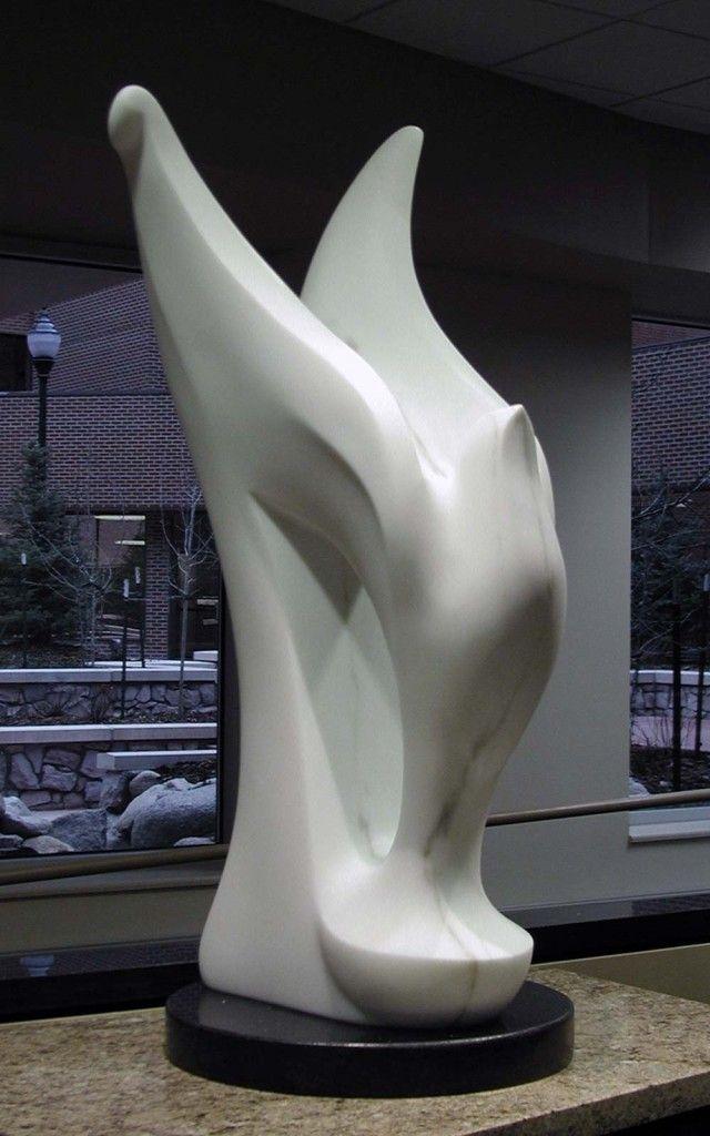 "<em>COMPASSION</em>, 2004, 42""H x 20""W x 22""D, marble on granite"