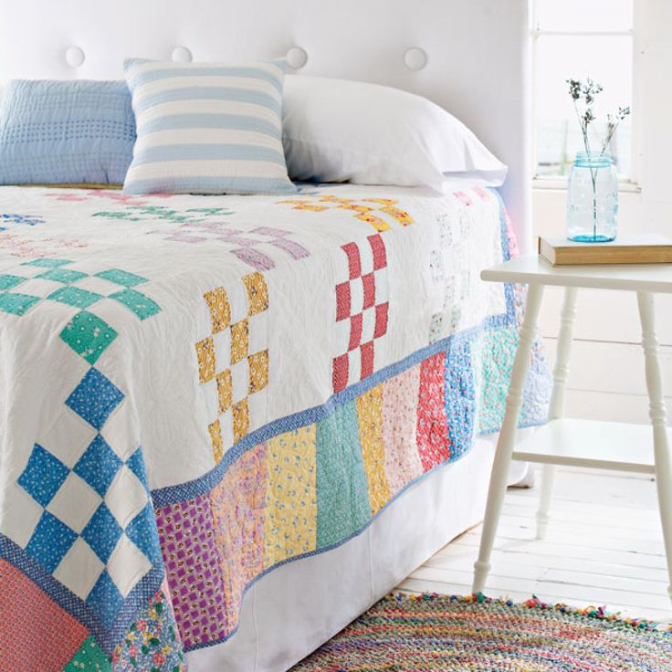 Lighten up a guest room with a 1930s bed quilt edged with random reproduction pastel prints.