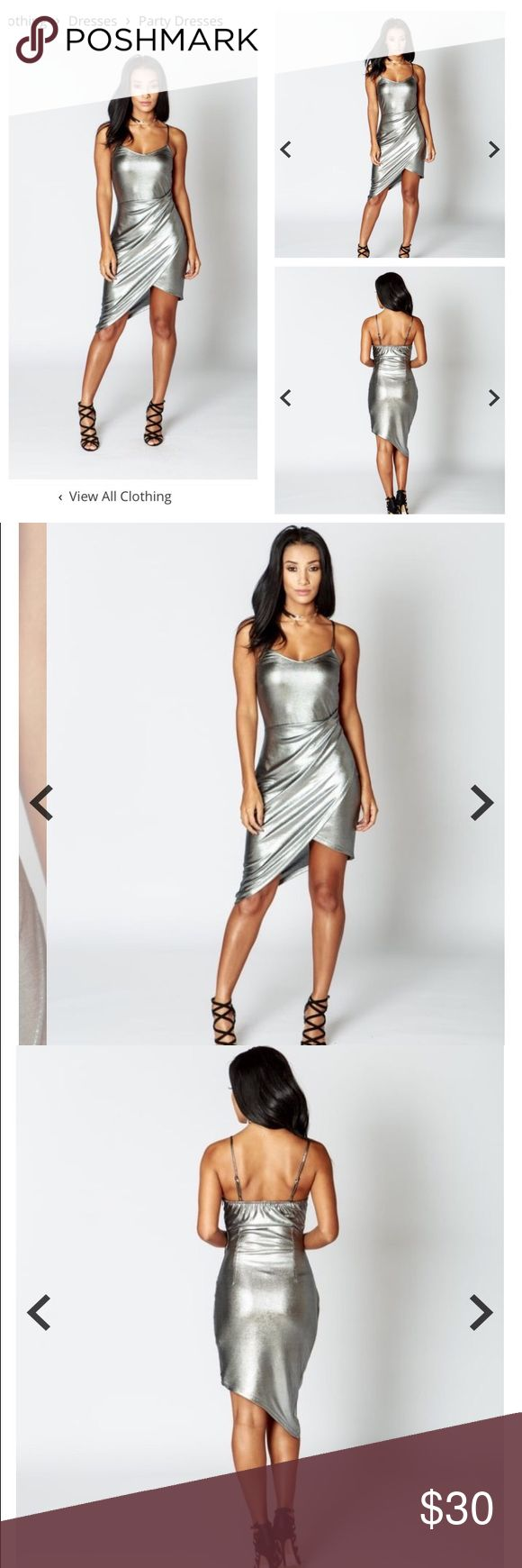 Silver Sparkle Wrap Dress This Silver Wrap Dress is PERFECT FOR NEW YEARS ! Made from metallic jersey fabric ! Comment below to reserve yours once it's in stock ☺️ pricing will be $25+shipping. Remember : items are in UK sizes, conversion chart is available Dresses Asymmetrical