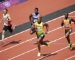 Jamaica's Yohan Blake (R) runs to finish first ahead of Nigeria's Peter Emelieze (L-2nd R), Guyana's Jeremy Bascom, Japan's Ryota Yamagata, Saint Kitts and Nevis' Antoine Adams during the men's 100m round 1 heats at the London 2012 Olympic Games at the Olympic Stadium August 4, 2012.