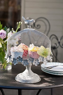 birdcage cake stand (not available for sale) - I've seen mesh domes like this to cover food; place silk flowers around the edge and a finial on top