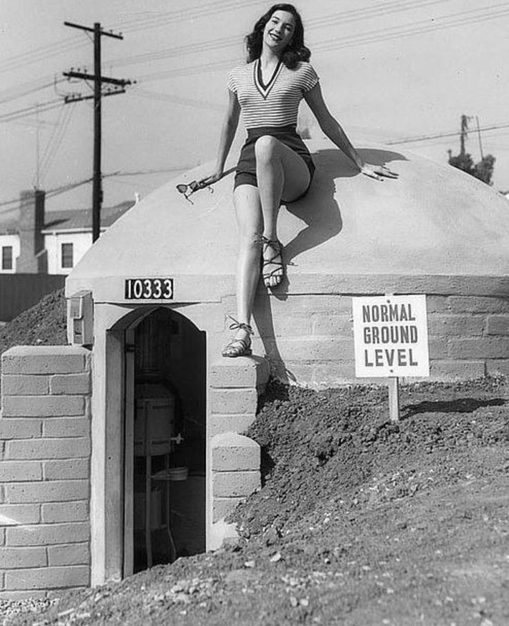 A model sitting on a model Atomic Fallout Shelter for sale in 1958 http://ift.tt/2eucmht