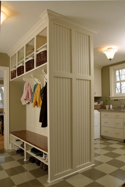 One big shelf on top. Cubbies, possibly cubbies on bottom for baskets for winter accessories