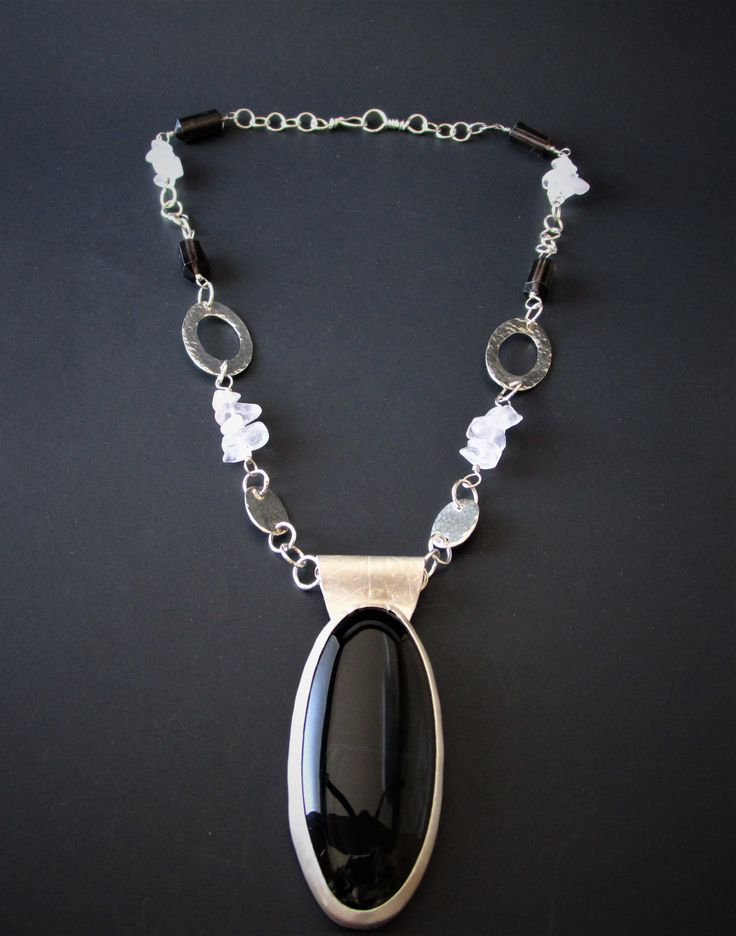 Statement Necklace - Black banded Agate, leaf bail, handmade chain with Rose Quartz and Smoky quartz details. Sold on Etsy.