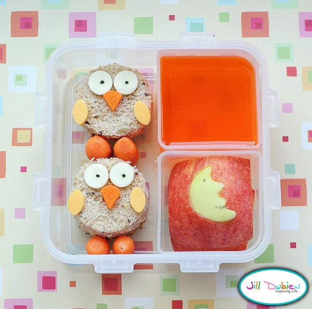 I just love this one because I have a slight obsession with owls. I made 2 mini circle sandwiches with turkey and cheese and decorated them with mozza cheese and food marker eyes, carrot nose, cheese wings and carrot legs. A container of orange jello - remember I make 1 package of jello ahead of time and it fills 4 of these containers so I can put jello in her lunchbox anytime. I also sliced a red apple and made a yellow apple moon cut out for it.