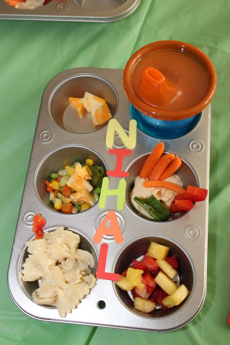 Kids dinner in personalized muffin tins. Water, cheese, mixed veggies cooked in butter, hummus with veggie sticks, Alfredo pasta, fruit salad. Perfect for any picky eater.
