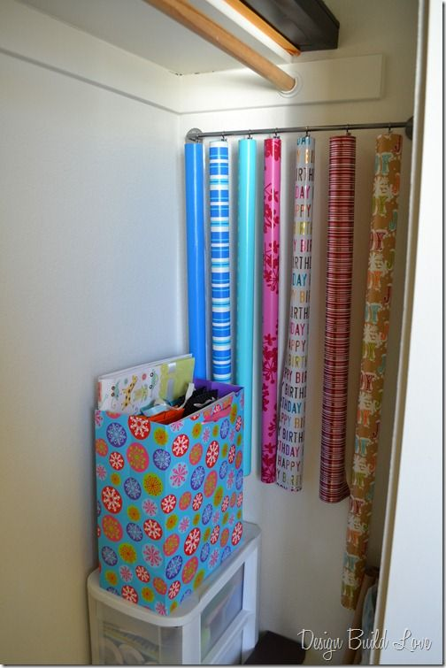 Use a towel bar with curtain clips to hang your rolls of wrapping paper in the back, unused corner of your closet. Since the clips attach around the entire roll, the end of your paper won't unravel.
