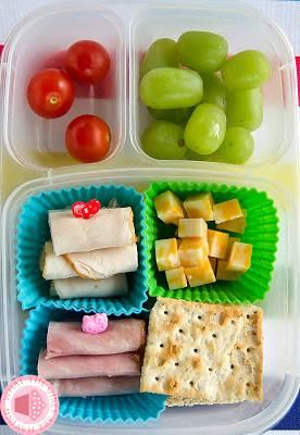 Quick easy Friday lunch, DIY Lunchable!  She has turkey, ham, cheese, crackers, grapes and cherry tomatoes.