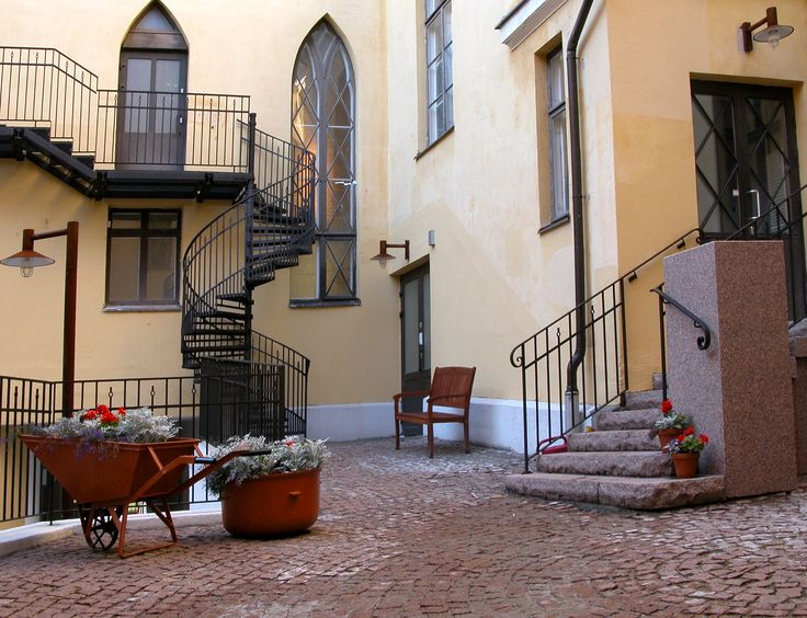 Helsinki, urban courtyard, fire escape, steel, brick, granite, rust