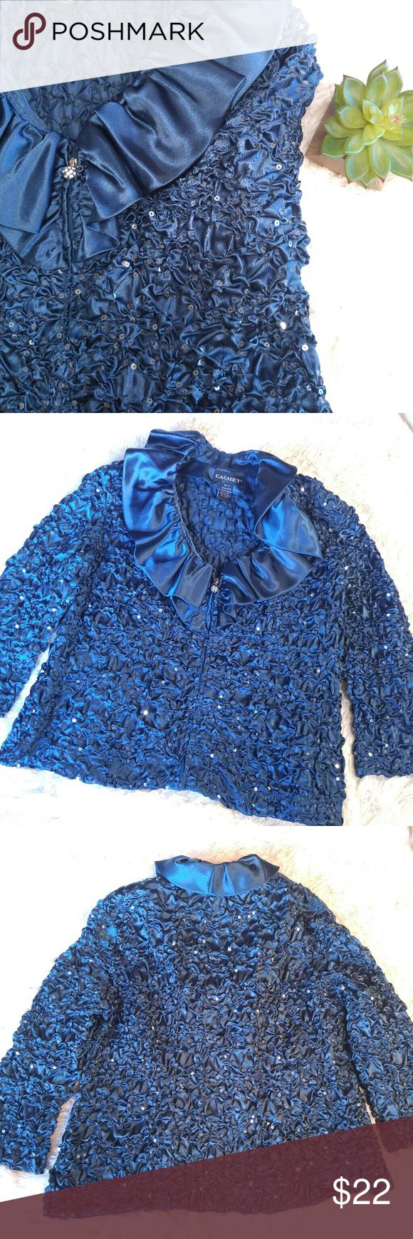 """Cachet Teal Sequined Pucker Satin Jacket Beautiful formal jacket with ruffled billowing neck, puckered polyester satin, and sparkling sequins. Zips down front and has three quarter sleeves and a rhinestone zipper pull. The color is hard to photograph, but it is a true blue green teal.   Size XL. 100% polyester. Some stretch because of the puckering. 42"""" bust, 24"""" long.   Has mark on tag, but otherwise good preowned condition. Very unique standout jacket. Cachet Jackets & Coats"""