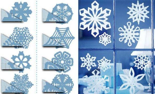 papier schneeflocken weihnachten fensterdeko schablonen