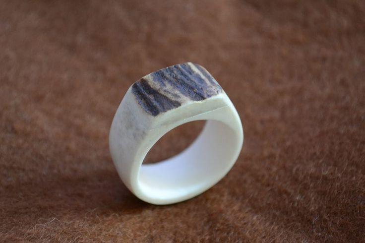 Bone ring with antler insert.