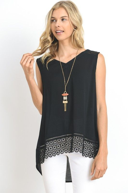 Kristen Eyelet Sleeveless Blouse I like that it has the detail on the bottom, more interesting than solid tops.