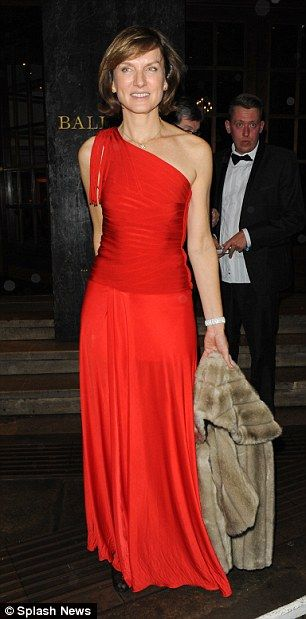 lady in red: one shoulder, figure skimming, vermillion red gown ... worn by news reader Fiona Bruce