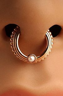 This triple ring. | 21 Unconventional Septum Rings That You Need Immediately
