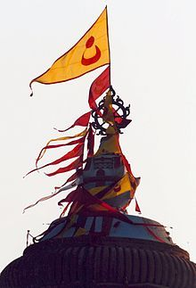 Jagannath Temple, Puri - Ritual chakra and flags at the top shikhara of Puri temple of Jagannatha also related to Sudarsana chakra. The red flag(12 hand or 14 Feet denotes that Jagannath is within the building.