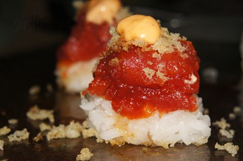 Chef Special Roll: spicy tuna, topped with tempura flakes and lightly covered with eel sauce and spicy mayo.