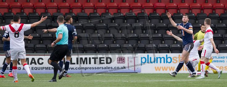Referee Greg Aitken points to the penalty spot during the Ladbrokes League One game between Airdrieonians and Queen's Park.
