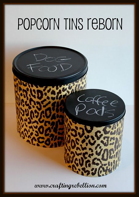 Cover popcorn tins with tissue paper using mod podge. Paint lid with chalkboard paint. Makes super cute storage bins!