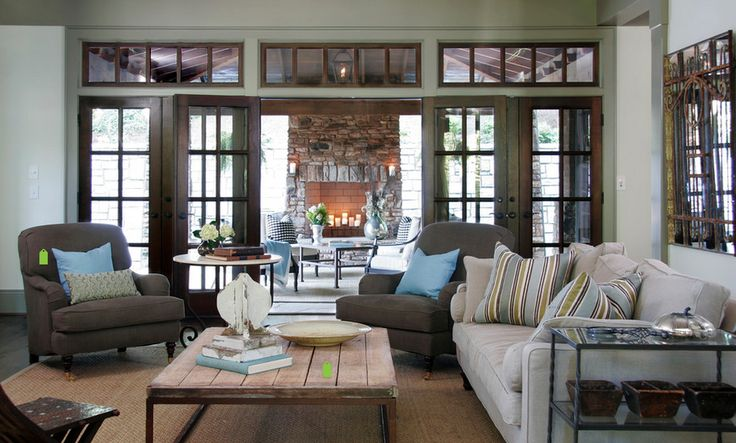 Family room french doors lead to covered outdoor patio with fireplace