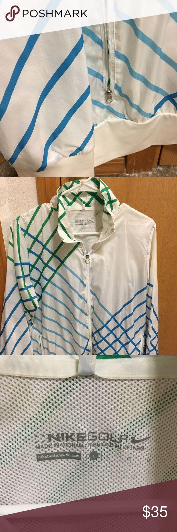 Nike golf jacket Gently used golf jacket. White, green and blue. Duel zipper. Zipper pockets. Light material. Nike Jackets & Coats