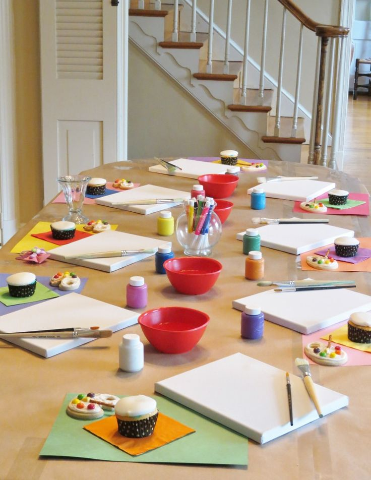 """Here is another great party for under $50!! This art-themed party was what my daughter, Emily wanted for her 9th birthday. Check out how cute everything turned out.We set the """"studio"""" (aka: my dining room) for 15 kids. The table was covered in brown craft paper and good ol' construction paper"""