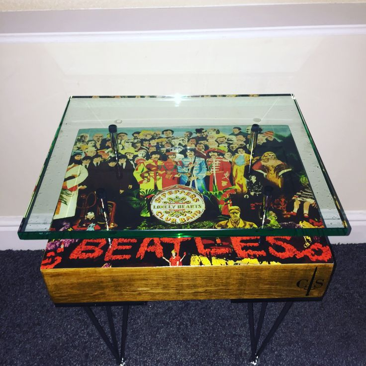 The Beatles Sgt Peppers French oak side table, chrome hairpin legs - chrome glass supports finished off with a 20mm thick glass top.