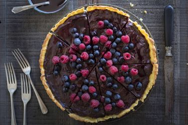 Chocolate and boysenberry crème fraiche tart
