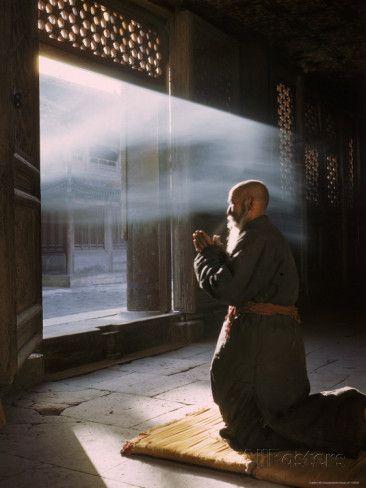 Taoist Monk in Prayer at Temple in Beijing