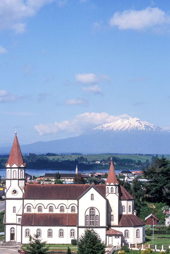 Puerto Varas (Lake District), Chile German style Cathedral built at the end onf the Nineteenth Century. Lake Llanquihue and Volcano Calbuco in the background. © Roberto Soncin Gerometta 2003