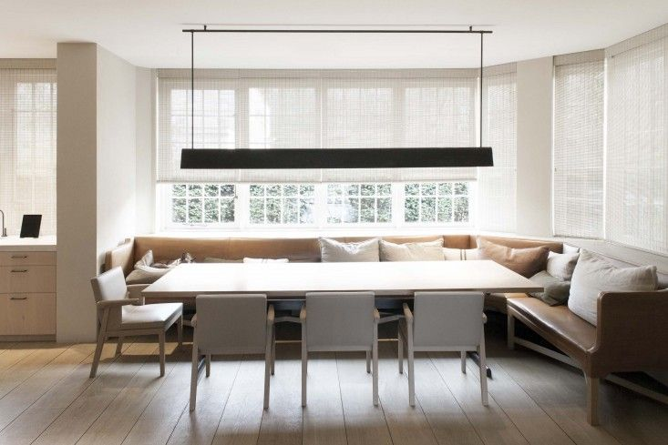A 1920s house near Antwerp remodeled by Vincent Van Duysen | Remodelista  light fixture, leather banquette