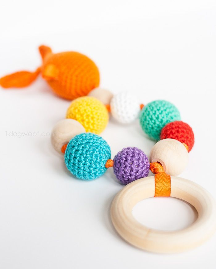 Goldfish and bubbles teether + rattle.  Free crochet pattern + instructions    www.1dogwoof.com