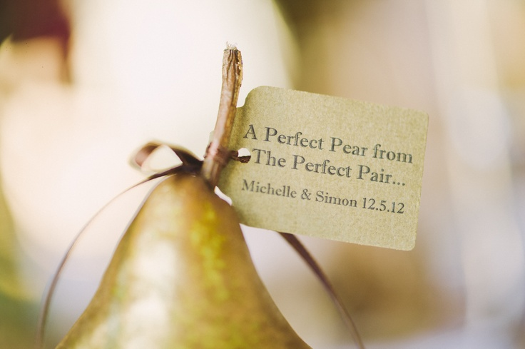 Pear Name Tags.  Pears were rubbed with gold wax and a maroon ribbon used to affix each guest's name with the pear quote on the back.